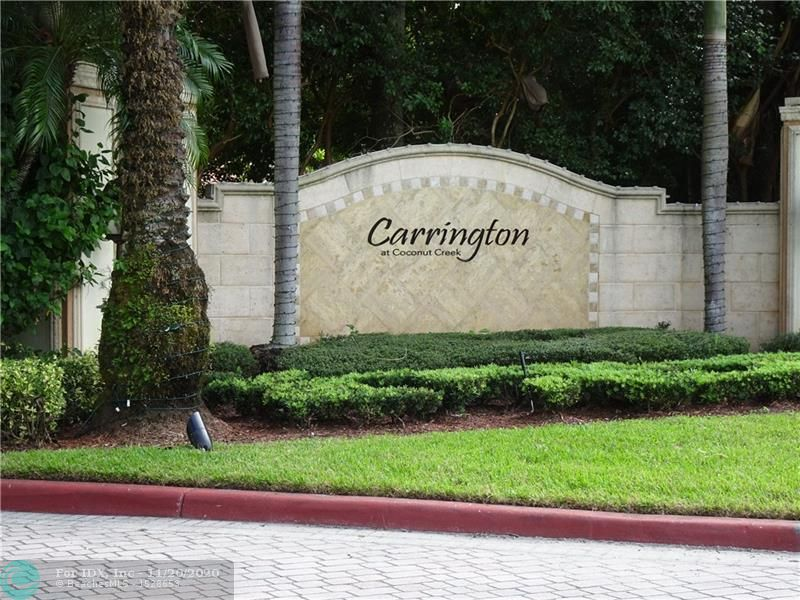GROUND FLOOR TOTALLY UPDATED CORNER CONDO OVERLOOKING PEACEFUL LAKE. LOCATED IN THE GATED COMMUNITY OF CARRINGTON AT COCONUT CREEK.  BEST LOCATION CLOSE TO SAWGRASS, I 95 AND TURNPIKE,SHOPPING AND A RATED SCHOOLS.  ONE CAR GARAGE, ONE CARPORT SPOT AND ONE UNCOVERED SPOT. IS INCLUDED IN THIS PRISTINE UNIT. 2 FULL BATHROOMS ARE ALL REDONE WITH WOOD CABINETS AND GRANITE COUNTERS. KITCHEN WITH STAINLESS STEEL APPLIANCES, WOOD CABINETS AND GRANITE COUNTERS. INSIDE WASHER AND DRYER.  SCREENED PORCH.  RESORT STYLE COMMUNITY OFFERS POOL, INDOOR RACQUETBALL,FITNESS CENTER, PLAYGROUND, SPA, TENNIS AND GATED ENTRANCE.Minimum credit score to purchase is 640