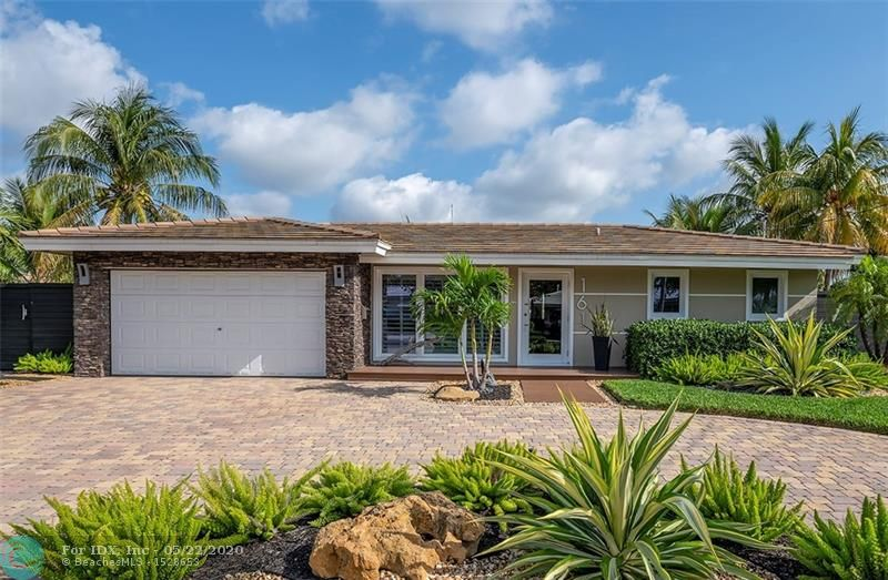 Waterfront Paradise Ocean Access! Located on prime lot looking down 138' wide canal in the quiet boating community of Garden Isles. This stunning home has been completely upgraded including impact windows/doors and is generator ready. Captivating water views from every room. Large dream kitchen features stainless steel appliances, Quarzinite countertops, crisp white shaker cabinets & large pantry. Spacious bedrooms w/ walk-in closets & new bathrooms w/ 1st class finishes. Gorgeous Bostonian terrazzo floors, planked ceilings, bonus room w/ built-in cabinetry & custom crown molding throughout. Incredible lush landscaping w/ large covered paver patio great for entertaining. New dock electric/water & 10k boat lift. Minutes to the beach, dining, casino, shops & more. Hurry this won't last.