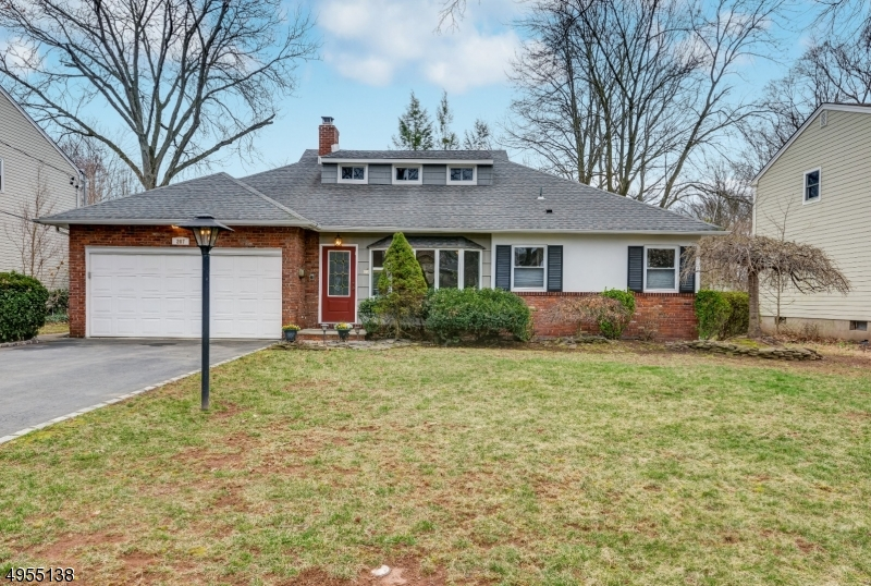 This expanded ranch boasts a new gourmet kitchen with white cabinets, granite counters and stainless steel appliances. Conveniently located near NYC transportation, Cranford's bustling downtown and recreation make this a must see. The home is light and bright with a large Bay Window in the Living Room as well as a Wood Burning Fire Place to keep toasty in the winter. First floor includes a master bedroom and bath, a second bedroom and main bath and home office or den.The second floor has two large bedrooms with a full bath. The large finished basement is bowling lane length and includes a laundry room, full bath and storage.  The home has three zones for heat and two zones for central air. Attached is a two car garage with enough room for cars and storage. all on .23 acres.