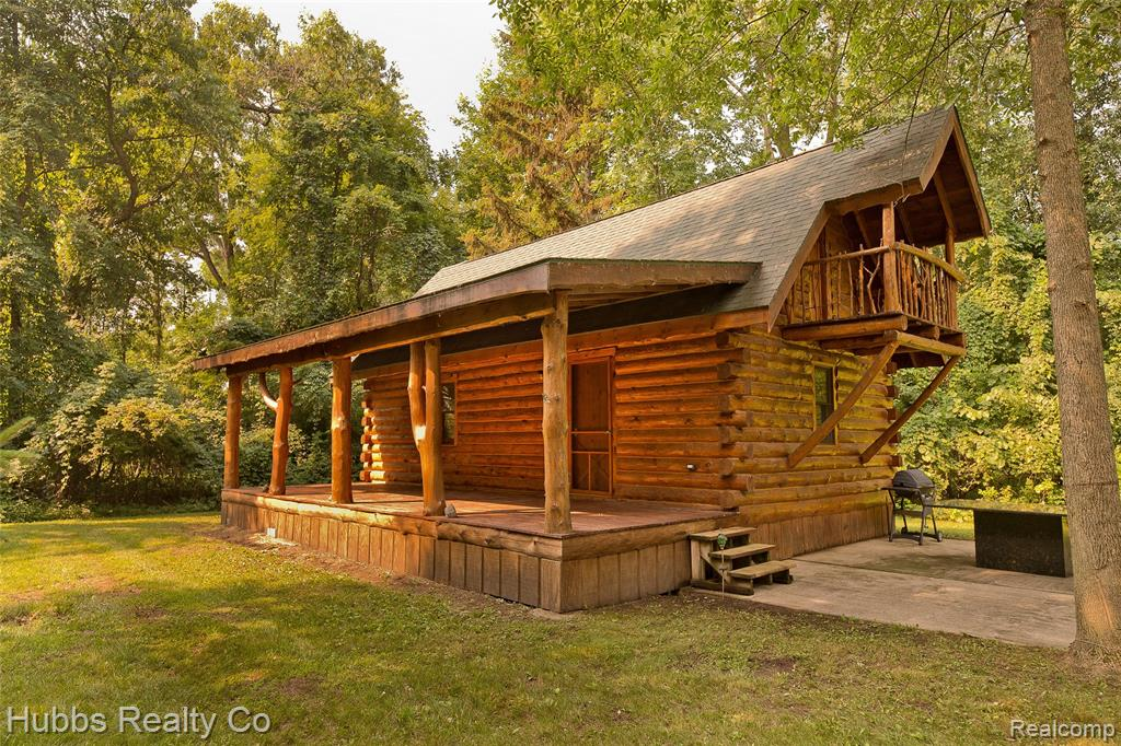 Absolutely stunning, Amish-built log cabin within walking distance to the Saginaw Bay/ Lake Huron/ Sunset Bay Marina. Get ready to have the time of your life! Beautiful covered porch to enjoy those peaceful evenings, plenty of space for entertaining, and a fire pit to cozy up to during those summer nights. Spiral staircase to the bedroom area and rapunzel's lookout loft! Spend time under the stars away from busy traffic, yet 30 minutes North of Bay City, and 40 minutes South of Caseville. This cabin has incredible character and is sure to please! Double lot, with room to camp, or build another place, and able connect power to an RV. Sellers will consider all reasonable offers. Call Hubbs Realty today!