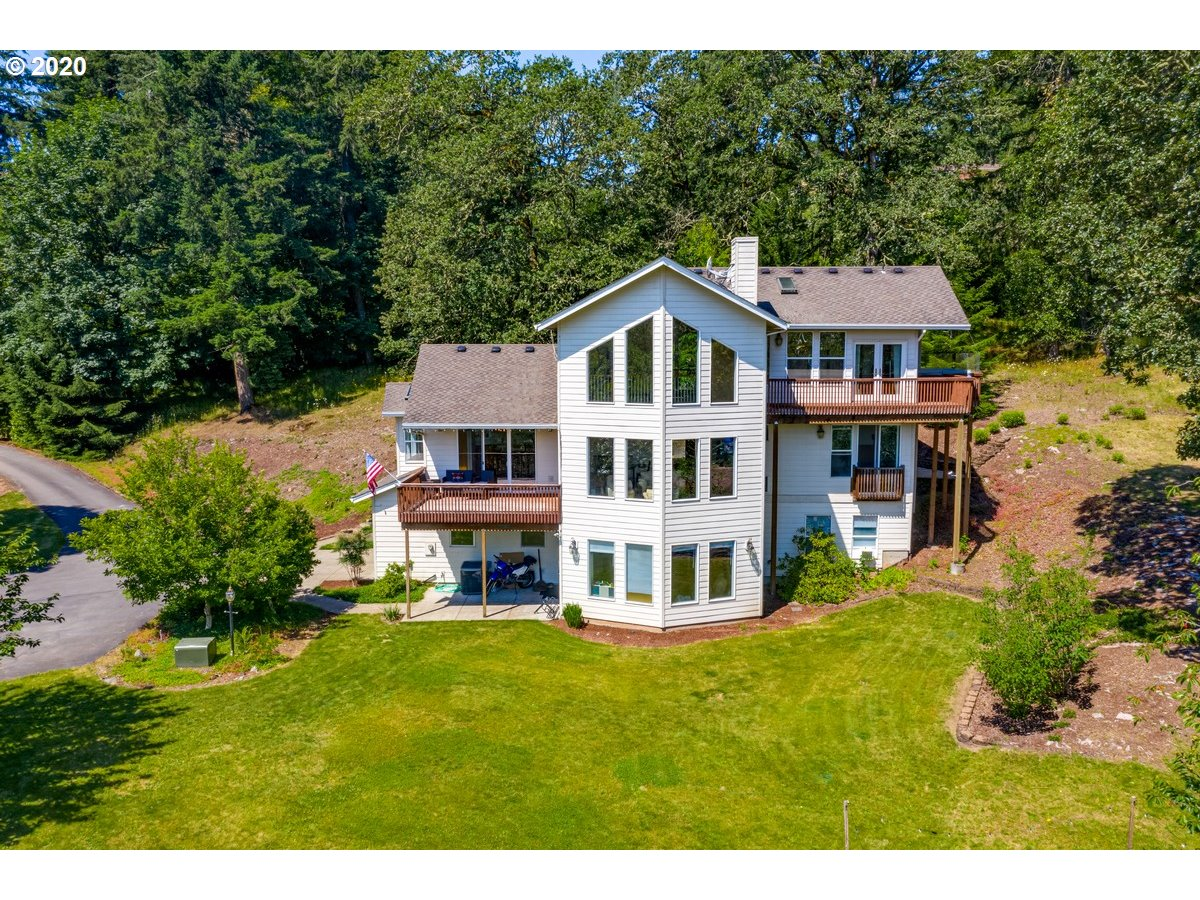 Stunning custom estate in gated luxury community w/gorgeous Mt Hood view! End-of-road privacy meets w/stunning finishes. Vaulted great room w/floor-to-ceiling windows & deck overlooking views. Spacious kitchen w/nook & 2nd dining area. Expansive master suite w/private deck. Versatile floor plan w/separate entry to lower level living offering options for multi-gen living/guests/tenant. 20ac w/room to roam/garden/play/entertain. Potentially marketable timber. Please view our Virtual Tour links!