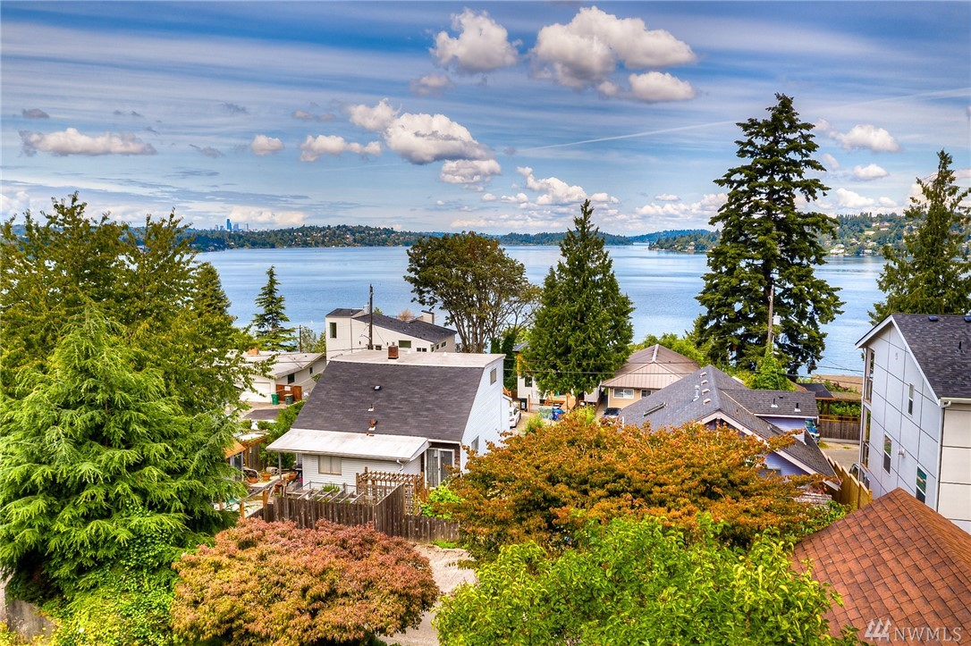 Stunning view of Lake Washington and the City of Seattle Skyline.  Enjoy the panoramic view from your dining room or deck. Remodel/ renovate this 1927 classic home to your taste.  2590 square feet of finished space. Hardwood flooring. 2 Bedrooms up and one on the main floor.  Detached 23 ft deep 1 car garage with large storage room/shop above for your extras. Plenty off street parking.  Superb location close to Seatac, Lakeridge Park, I-5 and Lake Washington.  Come check out the view!