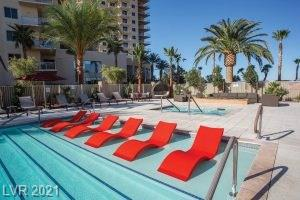AMAZING High Rise condo on S Las Vegas Blvd! Guard gated community, 11th floor with large balcony so you can enjoy the lovely mountain view, 1 BR/1 Bath  with granite countertops in kitchen & bath, separate storage unit included. BRAND NEW Manmade wood floors!! Tile floors in Kitchen & Bath.  Fabulous amenities include pool, sauna, 2 story fitness center, tennis court, party room, residents lounge, business center, movie theater. Condo is close to New Raiders Stadium, Town Square, and Airport. DO NOT MISS this one!