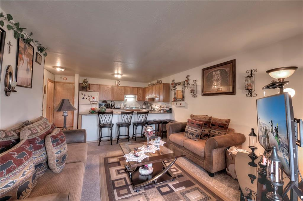 Great condo priced to sell quickly.  Current tenant is on month to month lease, has lived there for 4+ years and would be open to remaining if the buyer wished to keep them there.  This is a bright top-floor unit.