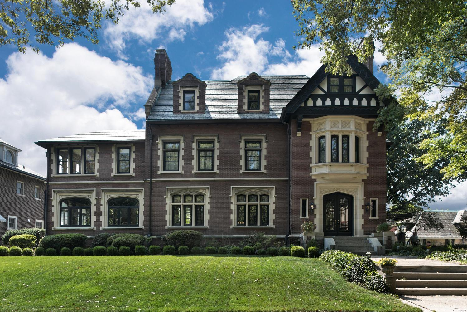 This handsome Tudor revival-style residence has been superbly restored to its original splendor. Outstanding architectural detail includes rare marble floors and walls, herringbone oak flooring, intricate leaded windows, hand-carved paneling and mantels,and breathtaking barrel-vaulted ceiling spanning the entire length of the living room. Updated kitchen,bathrooms,household systems and elevator make for a truly livable home suited for today's lifestyle. Master suite with a spacious bedroom,updated bathroom, dressing room,sitting room,and study. A large terrace, pool, pool house/greenhouse with spa, changing rooms, kitchen, and half bath are perfect for entertaining. A carriage house with guest suite and four garage spaces is located within the professionally landscaped garden which includes a decorative pond, mature trees, azaleas, and perennials. This remarkable home combines the best of Old World elegance with today's desired amenities creating the perfect setting for entertaining.