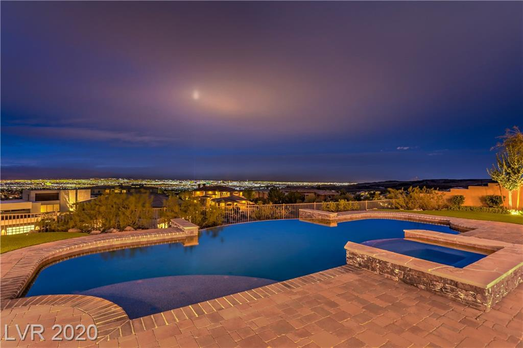 MESMERIZING FULL STRIP & MTN VIEWS! INCREDIBLE MASTERPIECE-GUARD GATED ANTHEM CC! LUXURIOUS LIVING SPACES, OVER THE TOP QUALITY FINISHES, POCKET SLIDING DOORS, HIGH END FUNCTIONAL KITCHEN OPENS TO FAMRM, GORGEOUS WET BAR HAS POCKET SLIDER WINDOWS TO SERVE AT THE PATIO. FABULOUS LOGGIA WITH SUPERIOR OUTDOOR KITCHEN, BATH, BAR & ENTERTAINMENT SPACE. SPECTACULAR MOVIE THEATER, ELEVATOR, ALL ENSUITE BEDRMS-2 MASTERS-1 UP,1 DOWN. EXQUISITE WINE RM