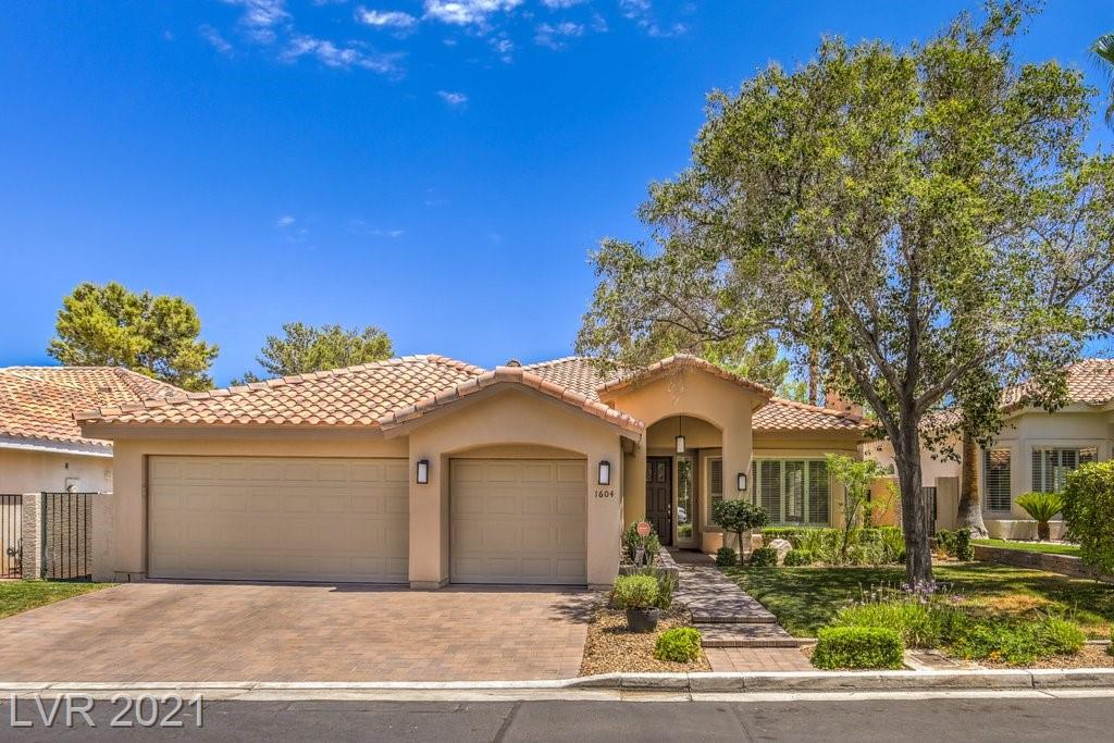 Pristine single story with 3 car garage in desirable Canyon Gate Country Club! Open floorplan with 10' ceilings allows for plenty of natural light. French doors from family room, kitchen nook and primary bedroom open to the backyard. Updates in the kitchen and bathrooms include white cabinets and stunning black granite counters. Huge Primary bedroom has 2 closets & bath with separate garden tub and shower. 3rd bedroom features dbl doors which makes for perfect home office. Raised planters and patio with pavers give a country garden feel to the private, south facing backyard. Lovely neighborhood features manicured lawns and community pool. Canyon Gate Country Club is  a guard gated, private golf course community. The central location at Sahara and Durango is convenient to shopping, schools, Summerlin and Boca Park.