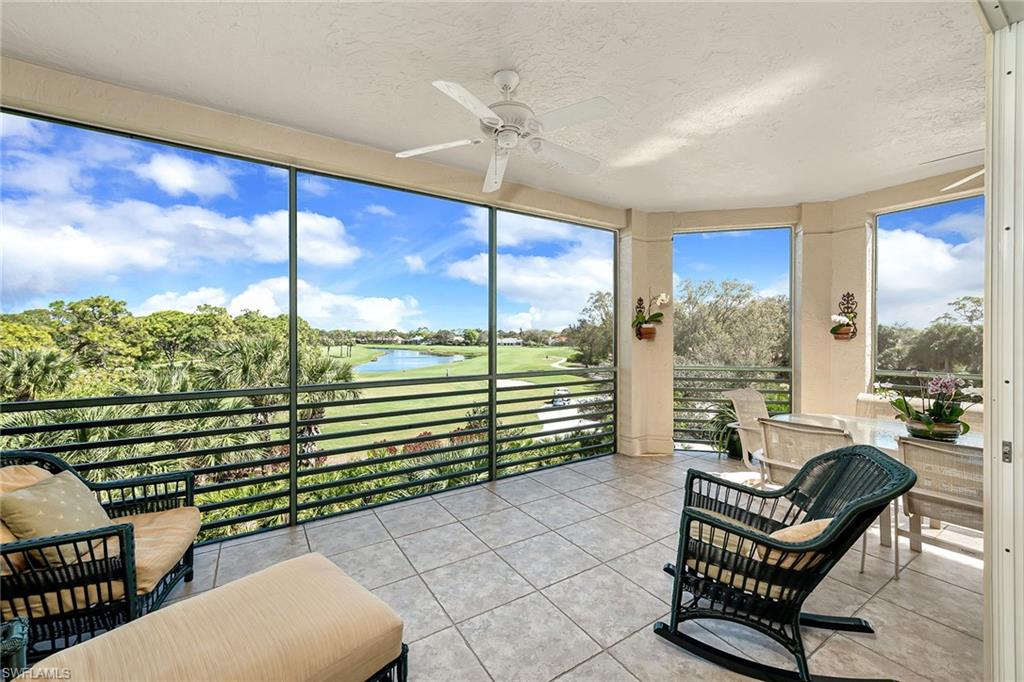 STUNNING, UNPARALELLED LONG RANGE VIEWS of the fairways and lakes that you will NEVER TIRE of! A beautiful plan that opens onto a wrap around lanai to enjoy every inch of the view! Enjoy the warmly renovated kitchen with custom cabinetry, newer appliances- including a wine cooler, and beautiful backsplash , extensive floor tile, lovely crown molding  and renovated master bath with a lovely  whirlpool tub. Generous interior laundry room with a window, and the guest suite and den are split from the master. Under the building two car assigned parking and storage. Conveniently located within Pelican Landing to enjoy all the amenities this community offers from its own private island beach park, to pickle ball to tennis, to kayaking to canoeing and so much more.