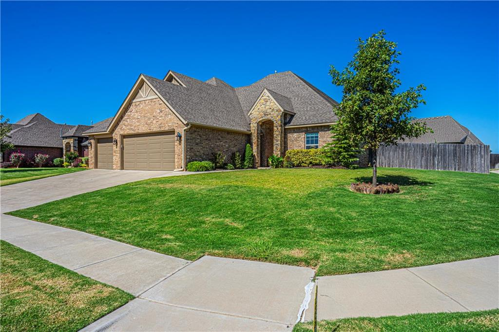 Rush Brook is a beautiful neighborhood located near Western & Danforth in Edmond just a short drive down Western or just 2 miles to HWY 74 to OKC shopping.  This 2014, like-new resale home has it all! A super flowing floor plan with 4 true spacious bedrooms downstairs, a true study, 3 full baths including a jack & jill w/separate lavatory rooms , upstairs is a sizable bonus room & 1/2 bath s great for media/play room. The Large corner lot is fully fenced around a big backyard with a lovely stained concrete covered patio for extra outdoor living space. The extra large 3 car garage has a brand new epoxy floor coating and in-floor storm shelter. Large open kitchen is perfectly functional with a large pantry, gorgeous island and wonderful appliance package. Beautiful wood floors in the living room, lovely master bath and walk-in closets for all the bedrooms.