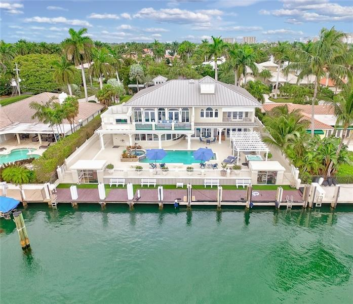 A beautiful transition from Mediterranean to a sophisticated Key West inspired home in the most desirable community in Ft. Lauderdale; Harbor Beach! Located on a 150' ± WIDE DEEPWATER CANAL/95' ± FT OF WATERFRONT. 6 Bedroom + Den + Office! So many upgrades including new metal roof, dock, AC's, kitchen, doors & more. This magnificent residence is truly move-in ready with two master suites, one conveniently located on the first floor overlooking the waterfront and the other featuring a large private balcony w/electric retractable shade. Enjoy hot tub, pool, full steam shower while entertaining friends & family. True Captain and Maid's Quarters w/separate garage entry into main house. 3 car garage and excess storage off the dock. A must see!