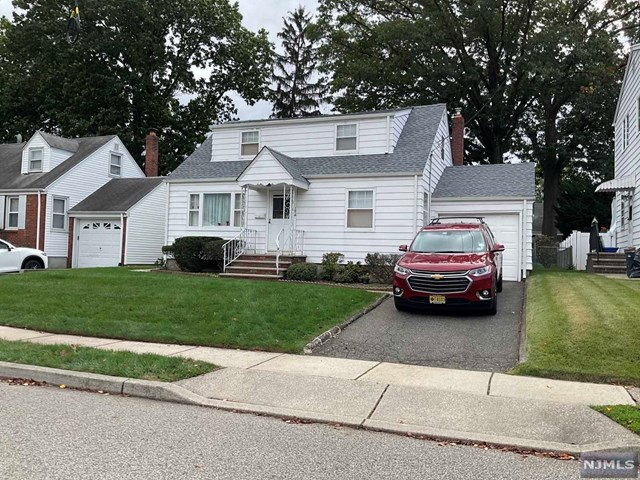 3 bedroom Single family home, featuring carpeting and hardwood floors.  Full, unfinished basement, enclosed back porch, driveway, garage, central A/C.  Great home and well kept !