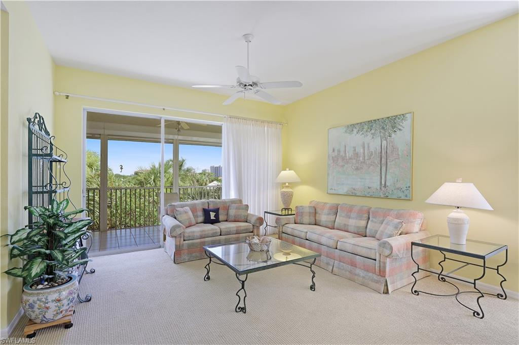 C3280 - A rare opportunity!  Own 1 of only 8 top floor end units with private Southwest exposure, views of the skyline and hi rises., volume ceilings and coveted 2 CAR DEEDED GARAGE.  This bright end unit offers picture windows that invite afternoon sunlight and a lanai protected by hurricane shutters that is accessible from primary suite & main living area.  A spacious eat in kitchen, great room floor plan, split bedrooms, foyer, separate laundry, & newer mechanicals are just some of the wonderful features this property offers.  Recent PC upgrades include new roofs, paint, lanai screens/railings, lighting, signage, numbering, landscaping, clubhouse & elevator entries.  One of the best locations in Pelican Bay across from & within walking distance of the North Tram.   2.5 miles/beach, 2 Gulf front rest., tennis, equity golf, fitness, kayaking & 500 acres of nature paths and parks.  Gated, on site mgr.., pet friendly.