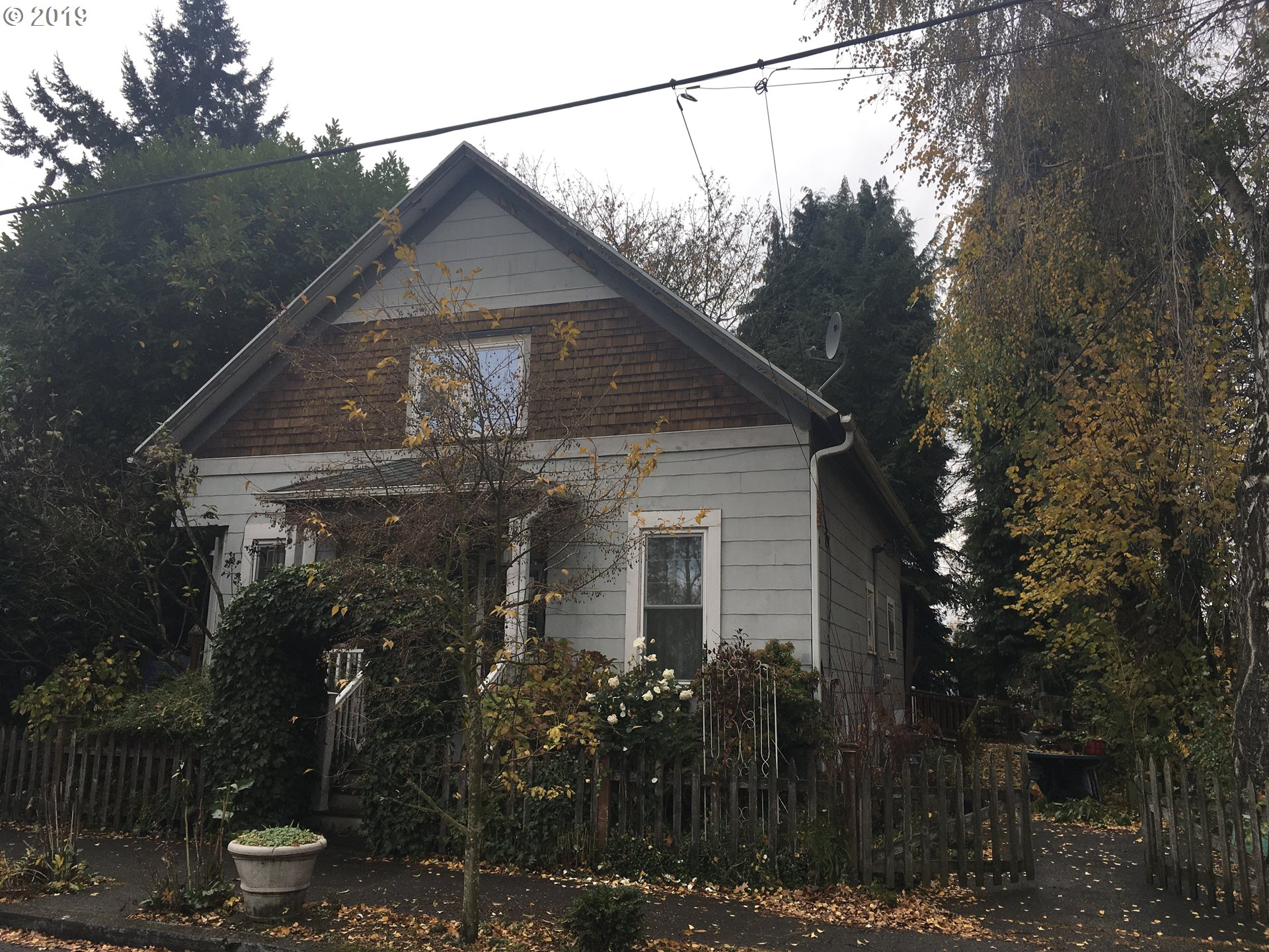 Super location and flexible zoning!  CM-2 (buyer to confirm all data w/city of Portland). Tons of character, full lower lever w/ kitchen, washer/dryer & full bath; ready for potential second living quarter/ADU/Air B&B! Separate entrance in place. Most newer windows, spacious back yard. So much potential here! [Home Energy Score = 3. HES Report at https://rpt.greenbuildingregistry.com/hes/OR10084494]