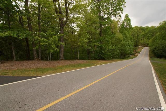 Gorgeous .9 acre lot located in Kenmure - A gated 24 hour security community. Great building site - ideal for walk-out lower level, which affords privacy. City water, natural gas & underground utilities. Kenmure amenities include clubhouse, fitness center, indoor & outdoor pool, tennis & golf. Membership optional.
