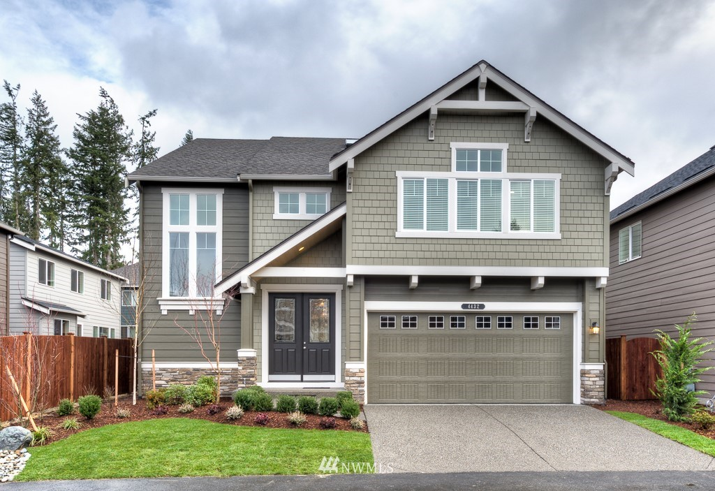 Hurry to see the ever popular Brighton home and make it yours! Vaulted 2 story entry flows to a open main floor dining-living-kitchen area built for entertaining. Very large island anchors the rooms and invites everyone to gather around it! Extra windows flood the space with light from all angles. Main floor bed/den rounds out the downstairs with a three quarter bath & built-in shoe drop nearby. Upstairs hallway is very spacious and creates a generous entry to the Bonus room, three roomy bedrooms and an opulent suite with five-piece bath. Nice flat play area in the backyard.  Smart home features included!