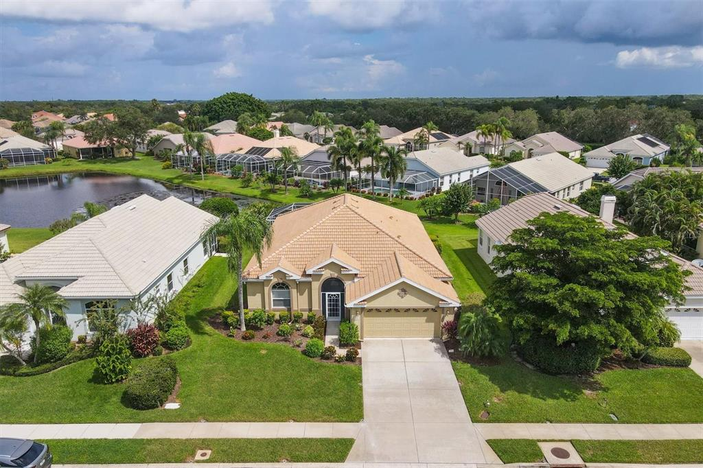 LIVE ON VACATION NOW! Start living the Florida Dream in Mote Ranch, is Sarasota's Best kept secret! This GORGEOUS COMMUNITY has LOW HOA fees and NO CDD! This fabulous home is IMMACULATE inside and out! * NEW BARREL TILE ROOF 2019! * A/C NEW 2020 *NEW POOL HEATER 2021 * 2 Reverse Osmosis and a Water Softener! Relax in your own HEATED POOL with peaceful lake views! The Pool deck has Brick pavers and pool was recently redone with PEBBLE TEC! You will love the floorplan! The separate Living room with Formal Dining room and a large family room off the kitchen allow lots of space for Entertaining or separate Family Space! Mote Ranch has a Community Pool, Walking Trails. Kayak Launch and is close to everything! Downtown Sarasota is only 10 minutes away and our World Famous Gulf Beaches are only 20 minutes away!