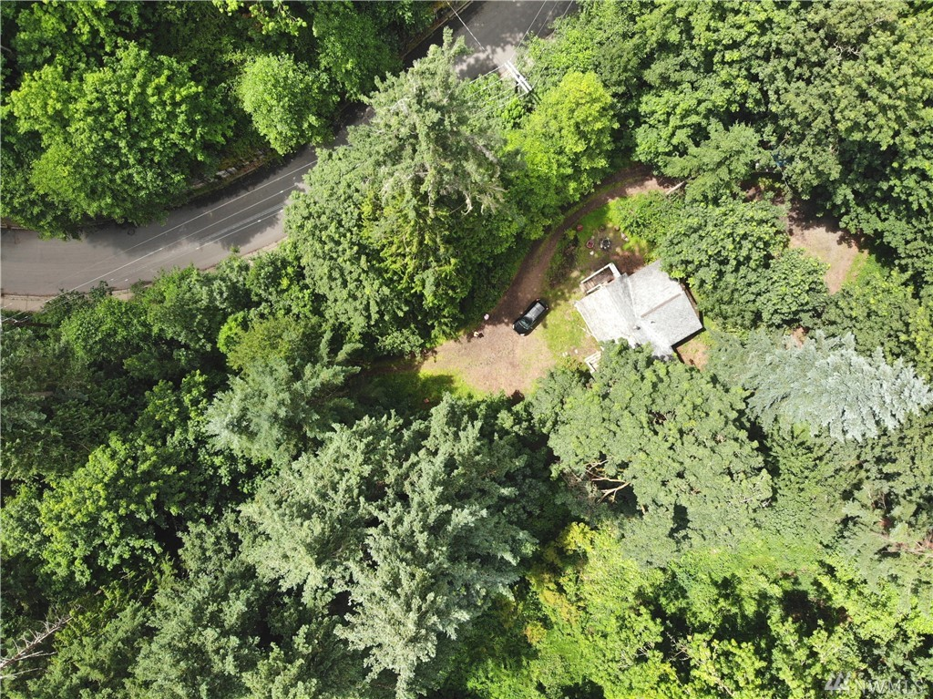 Bring your imagination and build your dream home here!!  5.3 acres on a dead-end street. Quiet, secluded country setting…you'll hardly know you're in town. Small home on property currently as well as a few unfinished outbuildings. Estate sized lot has an assessed value of $978,000. Don't miss this wonderful opportunity!