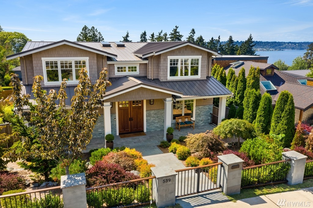 Exceptional custom home in enviable West of Market combines Hampton's-inspired architecture with transitional interiors. Purposeful plan brilliantly blends boundaries between indoors & out with 1,100 SF of covered deck/patios;while lake,Seattle & mtn views grace living spaces. Fabulous great room open to expansive view deck with 2nd kitchen & stone fire pit. Sophisticated master w/private view deck & fireplace. Main fl den; bonus/rec open to covered patio; ipe hardwoods on 2 floors; fenced yard.