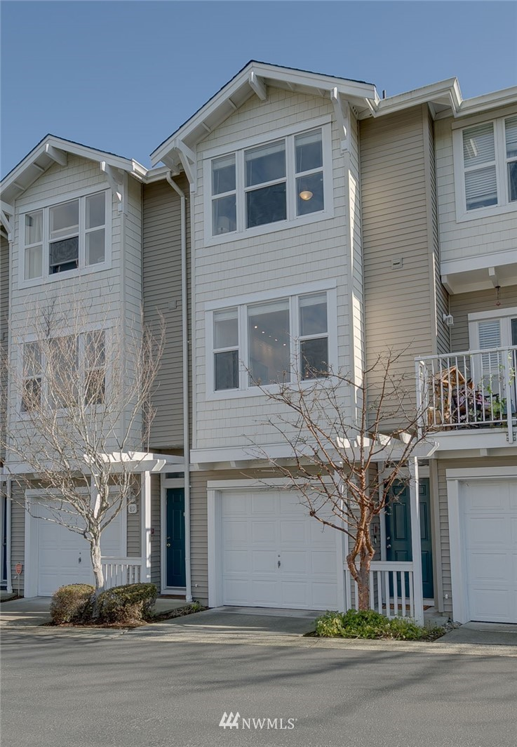 Stylish, sophisticated and fully remodeled townhome in sought after location in Bellevue. 2 bed/2.5 bath with west facing, mountain and city views from both living floors. Open floor plan with new LVP floors and carpet throughout with private landscaped fenced yard. Custom designed kitchen with built in workspace and fully renovated bathrooms with designer tile. Gas fireplace with built-in entertainment center with bookshelves, full size washer/dryer, and finished 2 car tandem garage with storage. New furnace and water heater. Minutes away from freeway access, Eastgate Park & Ride and Amazon Shuttles. Short drive to downtown Seattle and downtown Bellevue. Best-selling floor plan and No rental caps.