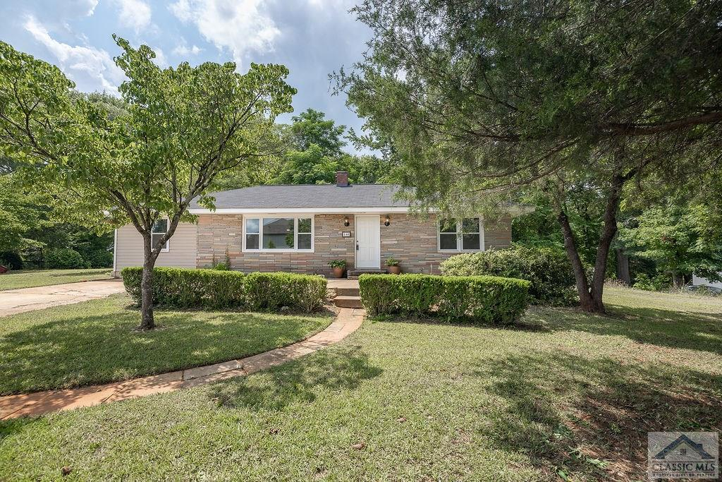 Welcome Home! Conveniently located near Athens 10 Loop on a spacious flat corner lot with mature trees and room for gardening. Large patio on front and at back. 4 Bedroom/2 Bath ranch style home. Brand new paint throughout. Living room features abundant natural light, new fixtures, and fireplace with new mantel. Off of the living space, you'll find the private owner's suite with dual closets and en suite bath, including new modern sink and ample storage. To the other side of the living area, there are three bedrooms and bath with new vanity. Eat-in kitchen with separate laundry room and convenient rear entry door. Perfect next home or income-producing property!