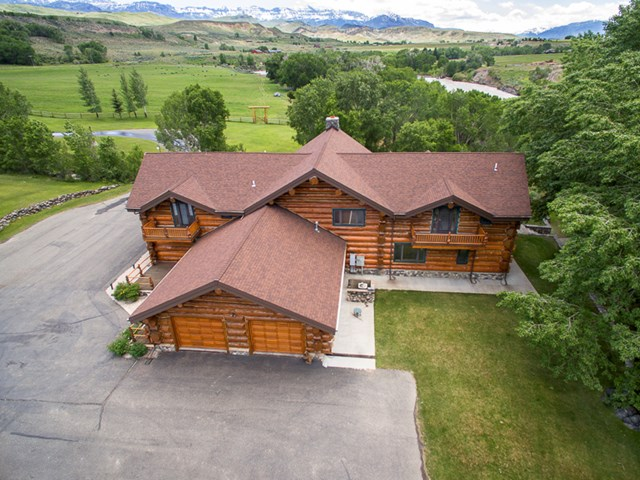 This ideally situated WY property has just over 42 acres of South Fork river frontage. The 5632 sq. ft. 4 bedroom 6 bath two story log and stone residence has expansive entertaining areas including a custom kitchen with subzero and Viking appliances, a wet bar and theater room. The burl wood wrap around deck is the ideal place to entertain. Keep your toys, horses or dogs in the 1224 sq. ft. shop.
