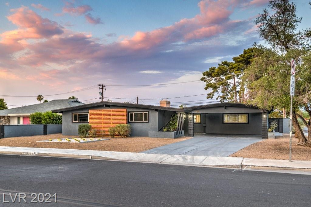 This Mid-century charmer has been Renovated and is a Stunning Single Story Home with a Huge corner lot with tons of potential! The kitchen has stainless steel appliances, New White Shaker Cabinets & black fixtures with a modern design. The whole house has 5-inch Baseboards, has been Freshly Painted, and has vinyl Flooring. Our Bathrooms have new custom tile showers and The Fireplace in the living room is adding character to this beautiful space. Grass in the Backyard with Gigantic pool with diving board & Unique outside bar. All this can be yours.Don't miss it!