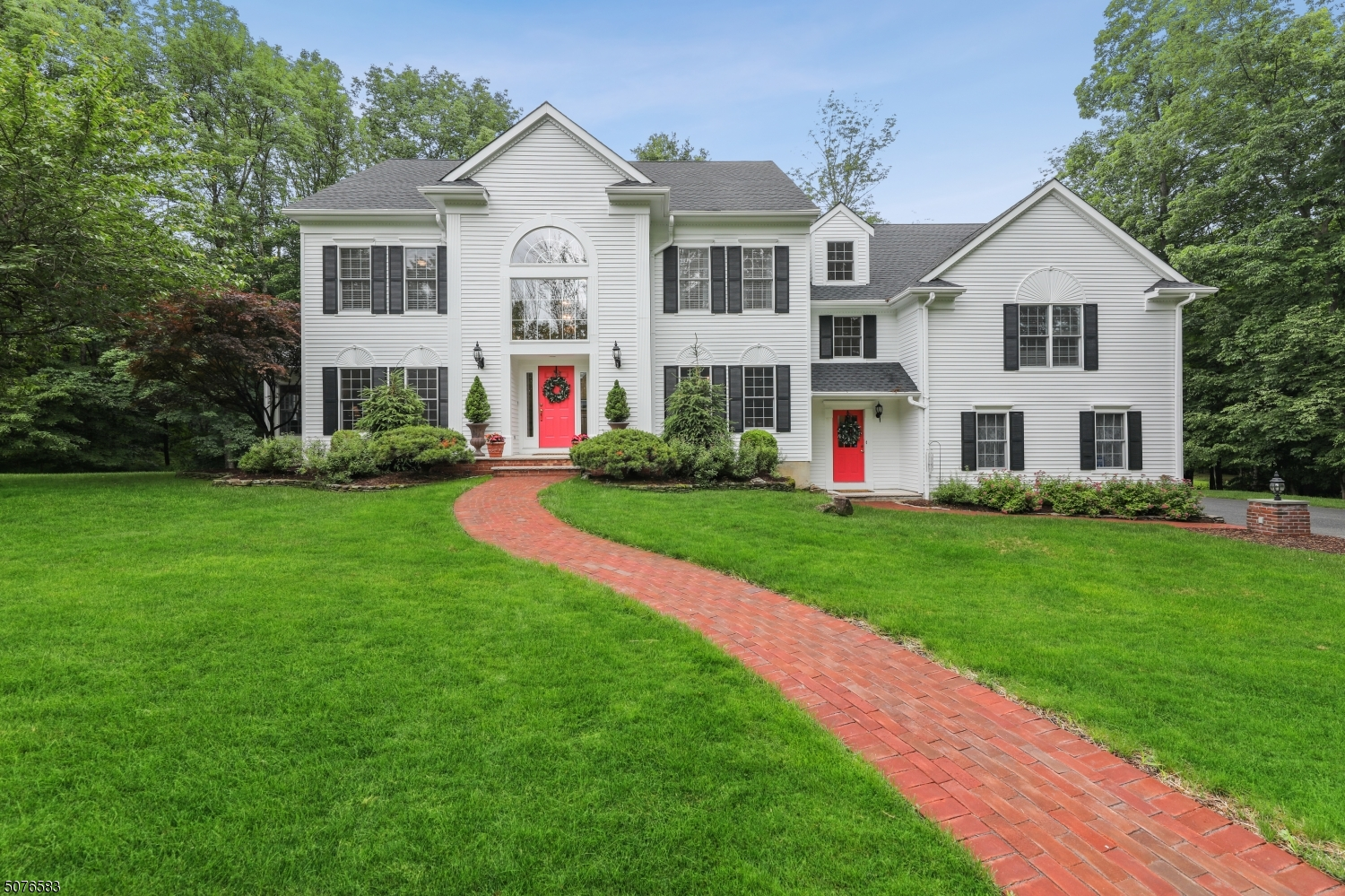 Gorgeous colonial located in a prime neighborhood with fabulous renovated kitchen and Primary Bath!  Light filled In-Law suite with full bath, fireplace in kitchen, family room and Primary bedroom. Located on a cul-de-sac, this property immediately lets you know your'e home.  The grand, yet welcoming two story foyer gives way to a professionally outfitted kitchen with fireplace. Open to the kitchen, the family room with fireplace, vaulted ceiling sunroom, expansive dining and living rooms offer endless entertaining spaces.  The primary suite with fireplace, sitting room, double walk in closets and on trend spa bath provide a sanctuary.  In-law suite with full bath, two additional bedrooms, an office and full bath round out the 2nd level.  Walk out lower level provides a third floor of perfect living spaces!