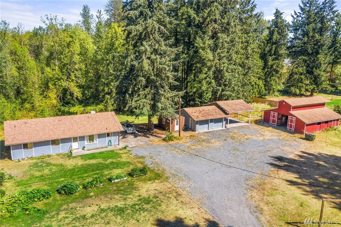 The Farmstead in Roy.  10 acres, 5 wooded/5 pasture, with 2 homes and a BIG red barn. The main home is 3 bed/1.75 bath with open concept kitch/living room, vinyl flooring throughout. Separate laundry/mud room.  Large deck for entertaining.  Detached 2 car garage, RV carport.  Big red barn with 5 stalls.  Garden spaces, lawn area. Fully fenced front pasture near the 2bd/1ba cottage (currently rented) at front of property. Close to JBLM and shopping.
