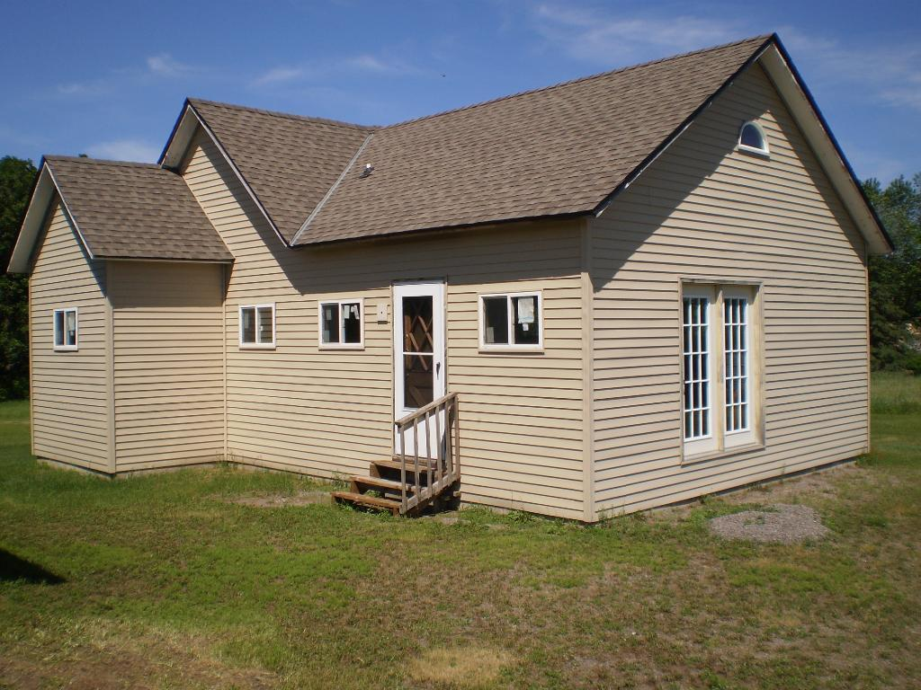 Amazing property with over 28 acres of wonderful wooded acres.  This home sits on the Elk River and offers some amazing views.  Bring your ideas and building plans.