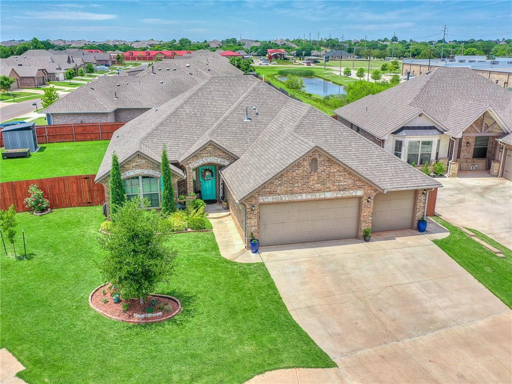 Immaculate & better than new in the desirable Rush Brook neighborhood featuring neighborhood pool and splash pad, playgrounds, etc! This fit for entertaining 4 bedroom home features tons of upgrades & finishes that will knock your socks off! Entry opens to large open concept living, dining and kitchen with stunning fireplace, built in speakers & windows to the back yard. Kitchen features granite counters, stainless appliances (fridge stays), custom cabinetry, pantry and a breakfast bar. You'll fall in love w/ the master w/ large walk in closet, jetted tub, custom floating shelves, separate vanities & a large tile shower! Secondary bedrooms are all great sized, with one at the front of the home that would make a perfect office! Enjoy the Oklahoma sunsets in your well appointed back yard, with stunning landscaping, hammock stand, covered porch with extended pergola area, storage shed, raised flowerbeds, etc! Landscaper's Dream! Great location, close to shopping, dining and more!