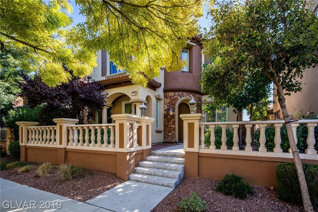 Looking for convenience - this community has it all!  Walking distance to Downtown Summerlin, Las Vegas Ball Park & Red Rock Casino, close to area golf  w/its own community pools, tennis courts & workout facilities. This RARE 3158 sq ft model(only 34 in community) offers gorgeous stone flooring on the 1st floor, hardwood in Loft & Master Bedroom, upgraded kitchen w/huge walk-in pantry, SS appliances & RARE 3 CAR GARAGE. THIS ONE IS HARD TO BEAT!