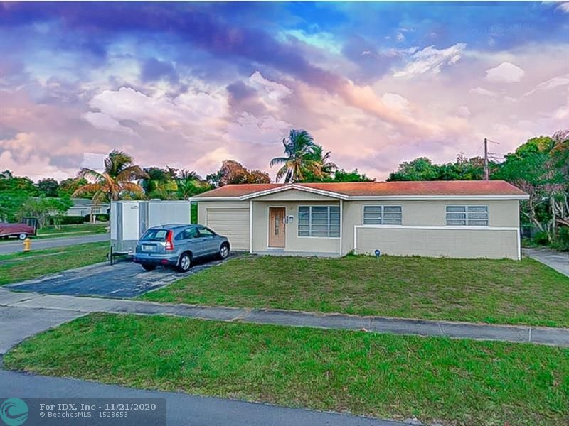 Great Opportunity! No HOA + Bonus Room. Huge updated family room with a working fire place, can easily be converted into two rooms.  3 bedroom 2 bathroom and 1 car garage equipped with Washer + Dryer. This home is on a corner lot 2 driveways for additional Parking. Updated Kitchen With Granite counter top, wood cabinets and a newer Roof. First time home buyers and/or Investors welcome.  Well Maintained. Must see to appreciate!