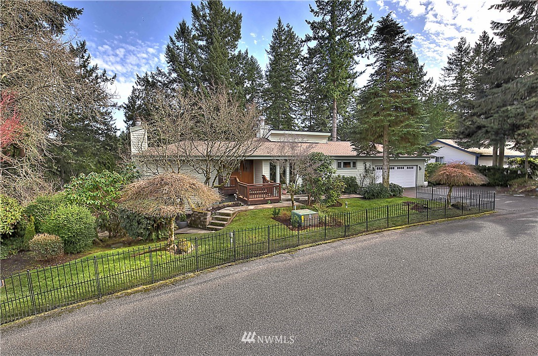 Gorgeous NW contemporary home steps from Chambers Creek! Custom built 3 br 2.5 bths & 2600+ sf home w stunning chefs kitchen feat cust cherry cabs & granite Wolf range wine fridge & 2nd sink connected to beautiful fam room that opens to amazing multi-level 2000 sf mahogany deck w/ custom lighting, fire pit & more. Cherry trim & doors. New roof & heat pump. Sauna w/ shower that opens to the ext, wired for hot tub, house wide music & SO MUCH MORE! Private setting makes this home a tranquil oasis!