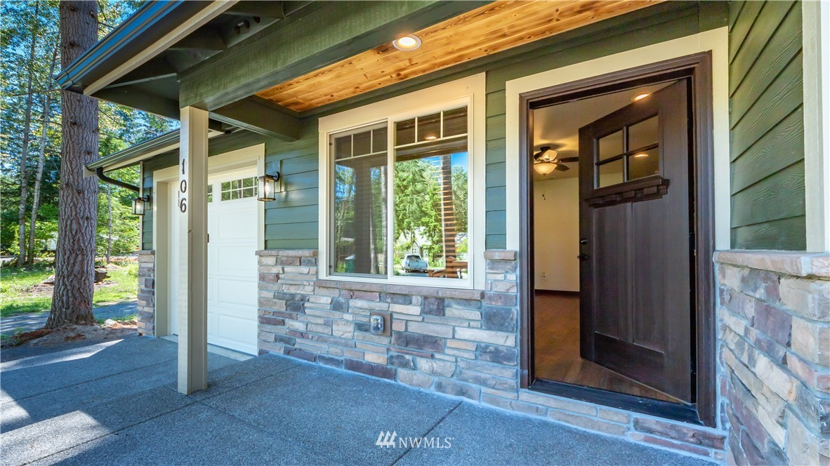 Custom New Construction home on .38 acre lot in sought after Elkhorn neighborhood. This gated community has views of the Gifford Pinchot foothills, is less than 20 miles to activities in Mt Rainier or White Pass & is walking distance to town! Enjoy watching the wildlife pass by while sitting on one of your covered porches. Step inside this beautifully built home to enjoy the openness of the kitchen, dining & living spaces. Home boasts live edge matte finish granite countertops throughout, custom lighting, solid wood doors, stunning wood flooring, electric fireplace, pre-wired for generator, huge master bathroom, custom closets & more. Utilize the insulated/finished 1 car garage or turn that 250+ sq ft into add'l living or recreation space!