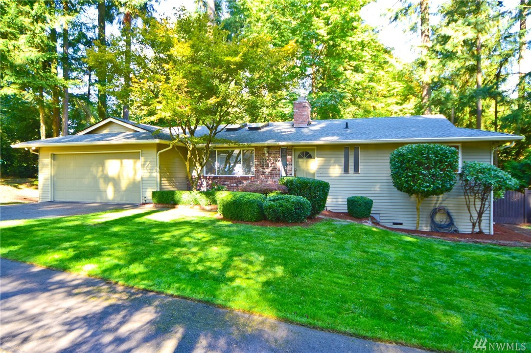 Beautifully updated rambler on a quiet cul-de-sac. Large 13,781 sf lot. Updated kitchen with gas stove. Updated baths, flooring, lighting, appliances, windows & more! Freshly painted interior. Huge 2-car garage. Spacious living room & family room with French doors to Large low maint Azek deck for entertaining. Large Fenced backyard with Raised garden beds...great for growing organic vegetables! Lake WA schools.  Fabulous location.... Easy commute to Redmond or Kirkland. Shows like a model home!
