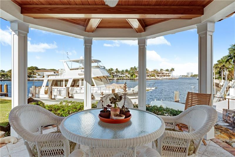 S. Florida living at its finest, inspired by wide waterway views out to the Intracoastal. Ideal for boating with deep waterfront & mins. to the inlet. Outdoor living under an open loggia complete with a full summer kitchen, fireplace & seating areas over looking the pool, large yard & daily parade of boats. Designed for entertaining with an updated culinary kitchen that opens to a large breakfast area, family room & wet bar. The formal living & dining room is ideal for intimate gatherings. The large master suite boasts 2 balconies with expansive waterway views, a fireplace, 2 seating areas, a large walk-in closet & spacious bathroom. Full home generator & tremendous storage spaces. Harbor Beach offers guard house entries, patrolled streets, a private marina & beach club. Sq. ft. from IMAPP