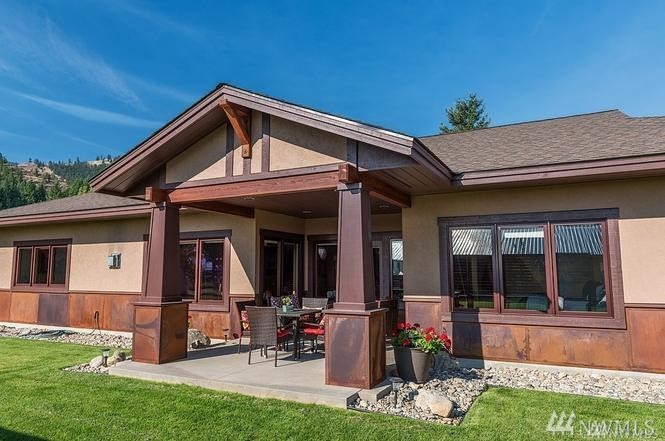 Gorgeous Design. Magnificent Precision. 2015 Prairie-Craftsman home, immaculate attention to detail. Stucco & weathering-steel. VG Fir interior with rich, craftsman-made cherry cabinets & appointments, exacting detail, perfectly executed. Box-beam ceilings. Exquisite granite. Loewen windows. Covered exterior dining. Luxurious master, 2 handsome guest BRs, 1.75 baths, utility, LG garage. Convection heat. Automatic propane generator. 1 level, no steps. LG in-town lot with irrigation & paved road
