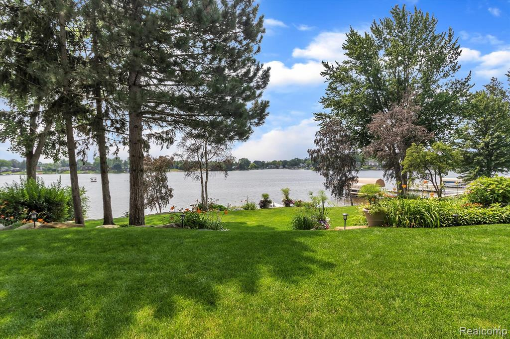 Privately nestled, custom built home on point of Lake Oakland (255 acre all sports lake). Frank Lloyd Wright inspired home w/103' of prime sandy bottom lake frontage!! Over 100 Pella windows for captivating sunrise & sunset views. Over 7,000 ft.², this home has 5 bed & 4.5 baths. Modern yet warm appointments will have you feeling at home. Features include open floor plan, glass railings on home & deck, 2 full kitchens; first floor kit equipped w/Wolf, ASKO & Sub 0 gourmet appliances. Convenient 2nd floor laundry. W/O LL & exceptional indoor/outdoor spaces designed for entertaining. Other notable attributes include heated radiant flooring and sidewalks throughout, Unico hi vol A/C, central vac, matching stone finishes inside and out. NO expense sparred, professionally & exquisitely landscaped with custom boulder seawall and complementing retaining walls. Absolutely stunning lakefront estate!!