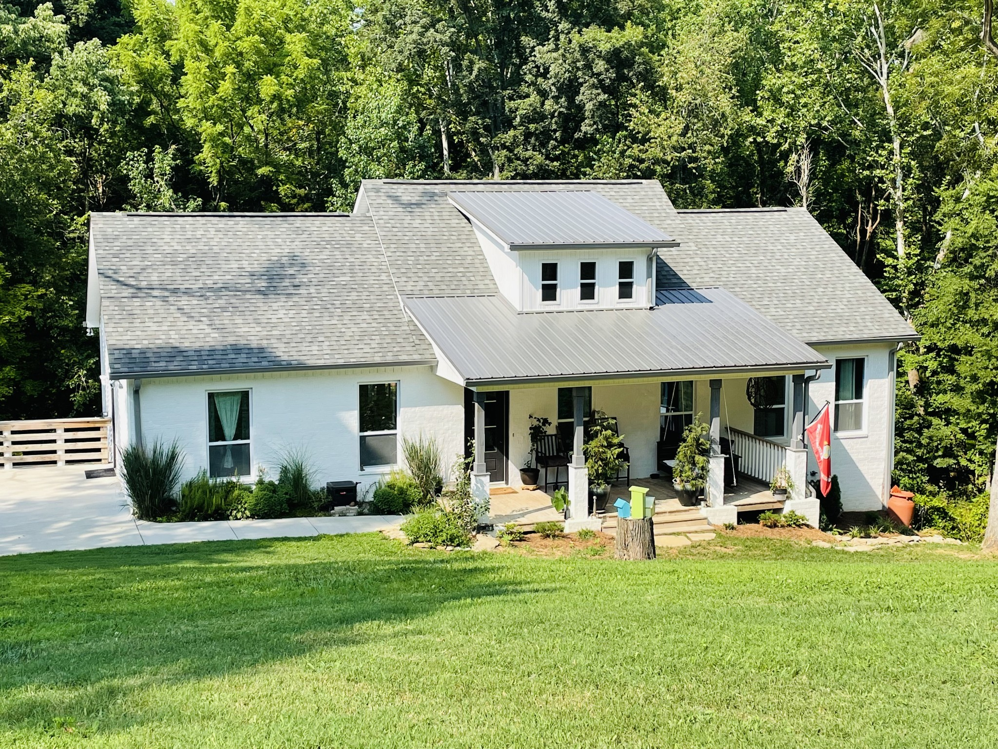 Look no further for your very own Custom Farmhouse on a quiet street. This home features an open floor plan with coffered ceilings, and large vaulted ceiling in living room. Custom cabinets with large island. Master suite on main floor, with custom built closet. Home has two 16x16 decks, overlooking the woods and creek, to entertain your guests or just to relax. Home is a half mile from old hickory lake boat ramps. Professional Photos coming soon!