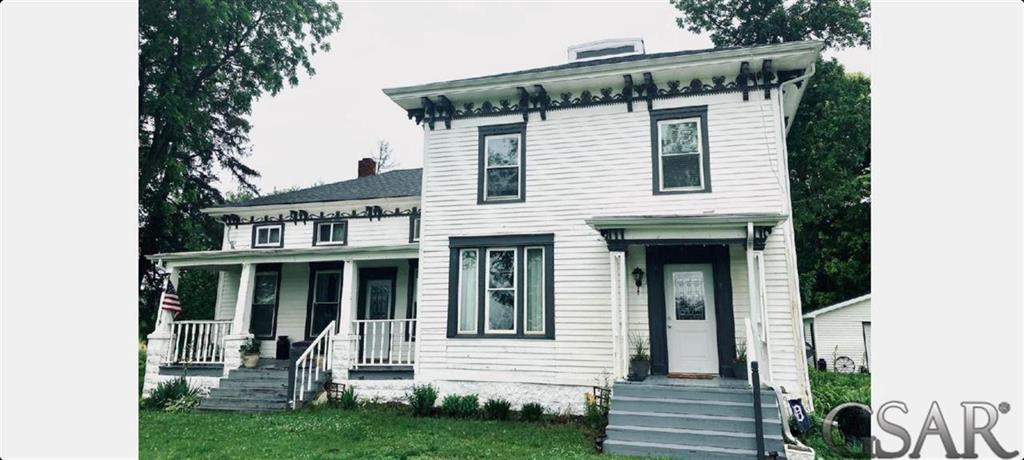 A rare opportunity to own a 4 bedroom, 2 bath historic 2785 Sq. ft. Centennial home in New Haven township, located at 1787 Henderson Rd. Owosso, MI. The property consists of 6+ acres of land with two outbuildings, including a 24x24 2 car detached garage with cement floor & electricity, 24x32 Pole Barn & a 20x30 car port. The property includes 2-3 ac. of mowed grasses, wildflower fields, 2 fire pits, mature trees, perennials, raspberry bushes, apple trees and hiking paths.  As to the house itself, original origin is 1880. The main structure includes most of the original woodwork and some original restored flooring. The original 4' Grand  Stairway with entry to the front porch and living room, gives way to the 2 main floors of living space, all with a walk-up attic to the cupola hatch.  A partial list of other new features include Kitchen cabinets, Furnace, Central Air, Water Softener, Entire Roof, New Wiring, 100 Amp Service, Whole house energy efficient vinyl double pane windows.