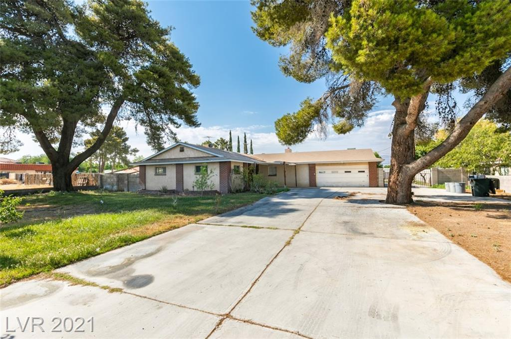 Rare opportunity in the NW! This 4 br, 2.5 ba (1/2 ba is pre-plumbed for shower), oversized 2 car garage sits on approx .5 acre! Enclosed sun room/patio, bar room, huge master suit w/ lots of closet space, sitting area & bathroom.  RV/Boat/Trailer/Truck parking!  Huge yard for a pool, horses, workshop, gardens & more.  Lots of fruit trees already planted - fig, pomegranate, lime, nectarine & apple! So much potential to fix this home up & revive it to its fullest.  2 swamp coolers plus central A/C, mult hot water heaters, all electric, septic system pumped & lines blown 4 yrs ago, 2 community wells for this neighborhood, fee currently $225/quarter.  This fee is for the wells only - this is not a traditional hoa.  Tons of potential with with a little TLC.  Home to be sold as-is/where is, seller will make no repairs. This has been a 1 family home passed down through generations, Seller will not entertain investor or flip offers.