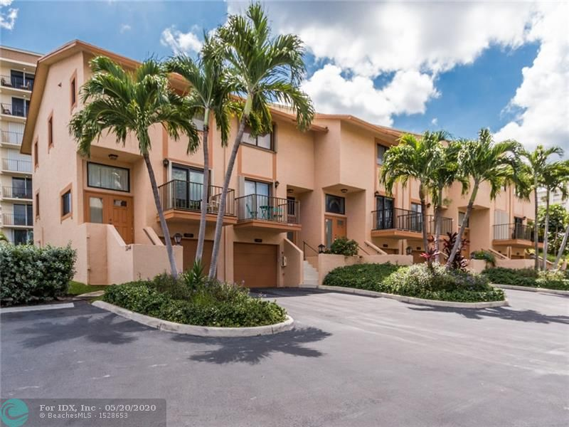 LIVE THE LIFESTYLE OF THE NEW POMPANO BEACH! THIS TOWN HOME HAS BEEN TOTALLY REDONE, 2 BED/ 3 BATHS WITH FAMILY ROOM CAN BE MADE INTO BEDROOM. WHITE SHAKER KITCHEN CABINETS WITH GRANITE COUNTERS WITH SPLASH BACK WITH RECESSED KITCHEN LIGHTENING ,WHITE TILE REDONE BATHROOMS & CABINETS. GRAY BLANK TILES,& GREY HIGH PILE CARPETING IN BEDROOMS.HIGH IMPACT WINDOWS & DOORS WITH 2 PATIOS FRONT & REAR ! PARK YOUR CAR IN THE GARAGE.AMAZING LOCATION TO BE ACROSS OF STREET FROM BEACH. POOL IS FOOT STEPS FROM YOUR FRONT DOOR ! NEAR ALL STORES,RESTAURANTS,MAJOR TRANSPORTATION & THE NEW POMPANO BEACH PIER. Just BRING CLOTHES & FURNITURE !
