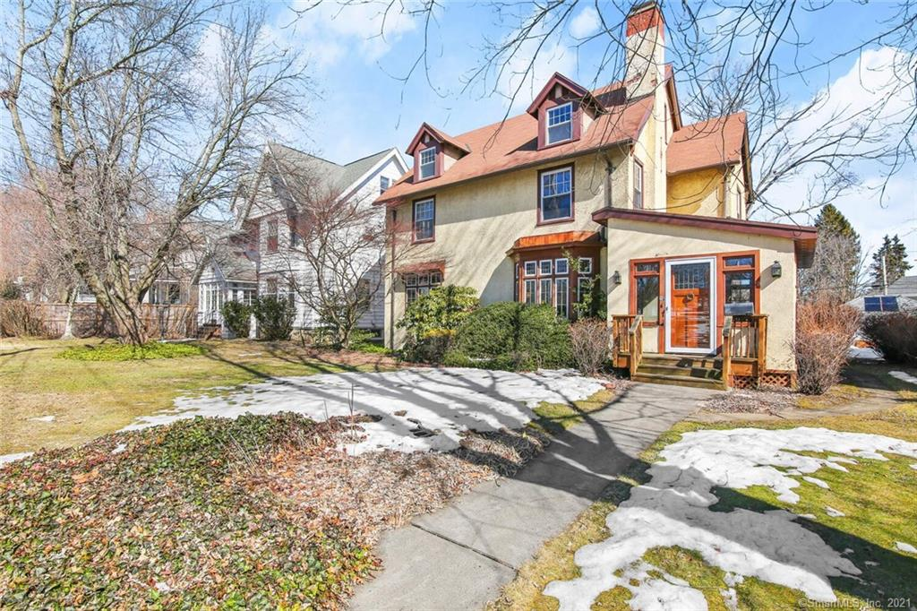 This charming 1916 Stratfield Colonial offers it all! Great period details and hardwood floors beckon you to the open and bright living areas throughout! The living room, with its welcoming fireplace, opens with an archway to the gleaming sunroom on one side and the attractive and welcoming dining room to the other which offers a stately and open feeling that comes naturally to a home built during this exceptional time-period. Offered throughout this home are period moldings, bright oversized windows, high ceilings, a butler's pantry and of course, a fabulous walk-up attic with a fifth bedroom and room for expansion to create your own dream space. A pleasant eat-in kitchen, with an oversized pantry, and rear stairwell add to the charm of this home. Great walking community with restaurants and retail are all within walking distance; and only a short drive to the Fairfield Metro Train Station!