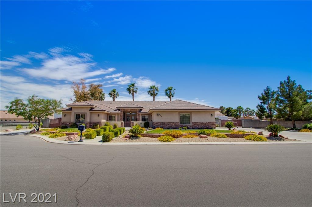 """Spectacular custom Northwest 1 story, 3 bd/2.5 bth home, 23,958 sqft lot, Sparkling pool/spa solar heated. Entertainers Delight! Cvrd patio, ceiling fan, stack stone outdoor kitchen. Detached garage approx 900 sqft. DUAL R/V PARKING 1 has 50 AMP/water & sewer connections. Courtyard entryway leads to yr beautiful formal living room, Tile/wood flooring throughout. Gourmet island kitchen, granite, stainless steel """"Kitchen Aid"""" appliances, custom wood cabinets, kitchen overlooks the entertainment room which features a wood burning pellet stove, Separate den could be used as a """"work from home"""" office/workout room with sink plumbed. Primary bedroom has vaulted ceilings, two way gas fireplace, ceiling fan, door leads out to patio/pool area. Enjoy spa like bth; dual sinks, large jetted tub, custom walk in shower with dual shower heads, custom walk in closet. Truly one of a kind; 2 hot water tanks, two Nest thermo, Bth have marble tops. Plenty of parking. You don't want to miss this one!"""