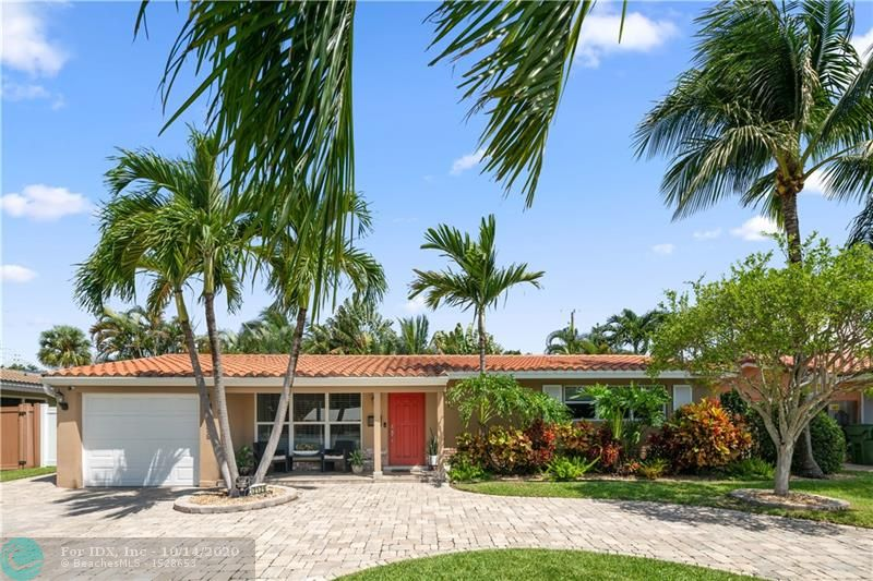 Tropical Paradise in sought after Imperial Point.  This 3/2 pool home has an updated kitchen with stainless steel appliances and granite, custom bathrooms, and ceramic tile throughout main living areas with carpet in the bedrooms.  Energy efficient impact windows and doors throughout and a new Trane A/C system with two supplemental mini split A/C systems to keep you super cool.  Separate oversized pantry and laundry room, tankless water heater, crown molding, and recessed lighting throughout. Custom garage flooring.  Private tropical backyard with pool and spa, perfect for entertaining and living the South Florida lifestyle.