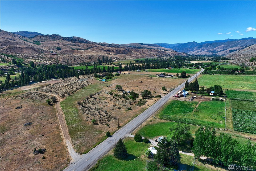 Beautiful 6+ acre property surrounded by larger parcels. Wonderful setting with multiple building sites to choose from. 400 amp service installed w/meter base &  power conduit stubbed out to three different sites, 55 gallon/per min. well w/ variable flow pump installed & functioning w/ water to 4 frost free spigots & stubbed out to building site. Historic home site with mature lilacs, apricot trees and shrubs. High tensile fence installed for horses.