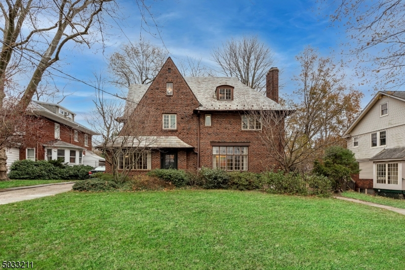 Fall in love with the past & present of 638 Prospect. This gothic Tudor sits proudly on one of Maplewoods most prominent streets, serving as an impeccably preserved portrait of 1920s architecture. Original character graces every room w/ oak floors & leaded glass, while rich wood paneling infuses the 1st floor w/ warmth & history. The expansive parlor & dining room are ideal for elegance in entertainment. All four 2nd fl beds have en-suite bath access, & the primary boasts original built-ins & walk-in wardrobes. The 3rd floor guest suite is accompanied by a large bonus room for storage or solitude. A home office  with separate entrance and waiting room help you live & work in harmony. The garden is a private oasis w/ koi pond & greenhouse. Become a part of the beautiful legacy of 638 Prospect. Welcome home.