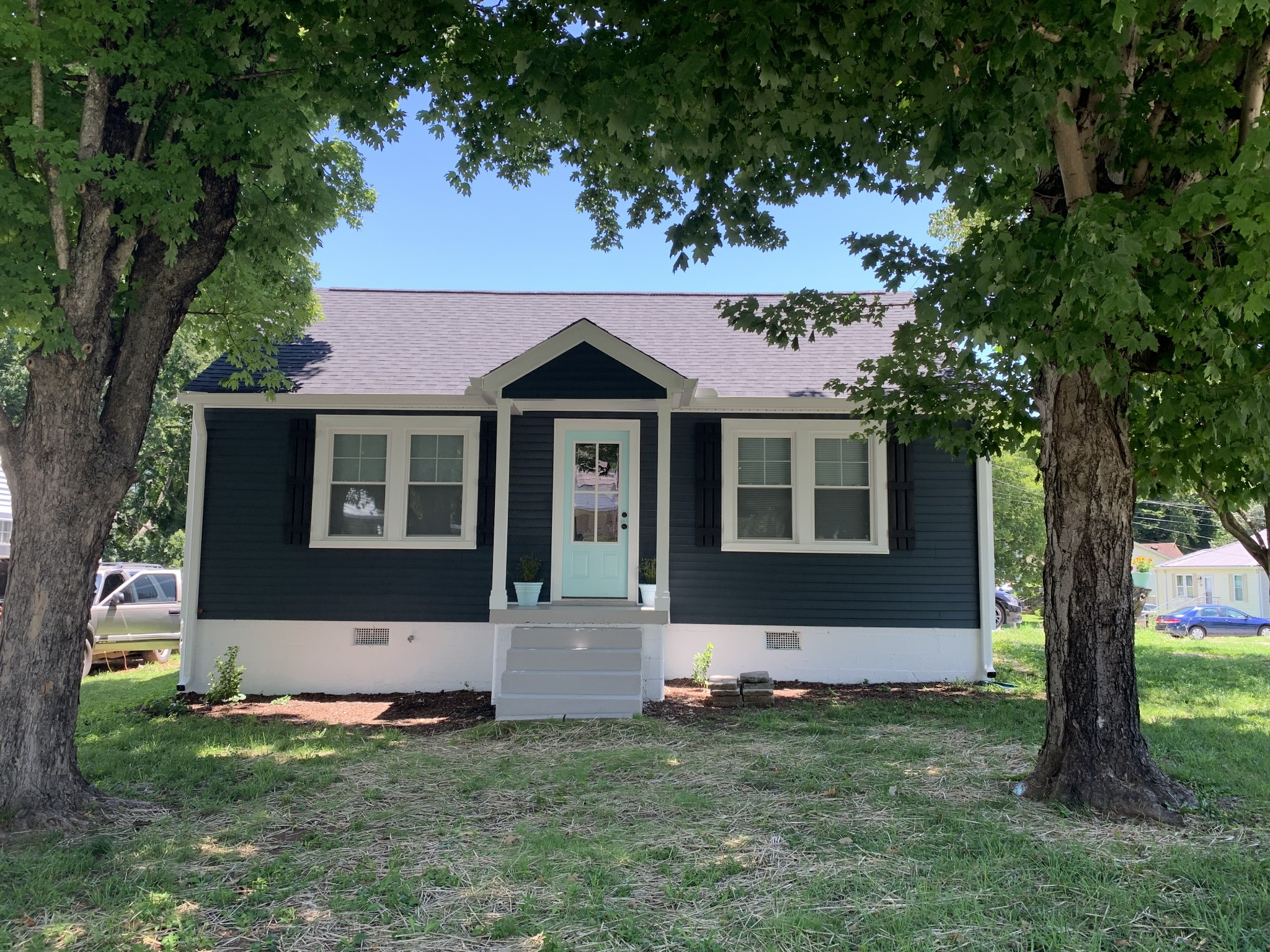 Home has been renovated inside & out with new exterior vinyl, gutters & windows. New Roof. New interior paint, new flooring & refinished floors, new cabinets & counter tops. New light fixtures.Ship lap in kitchen & laundry room as well as board & batten in bathroom. Home is move in ready.