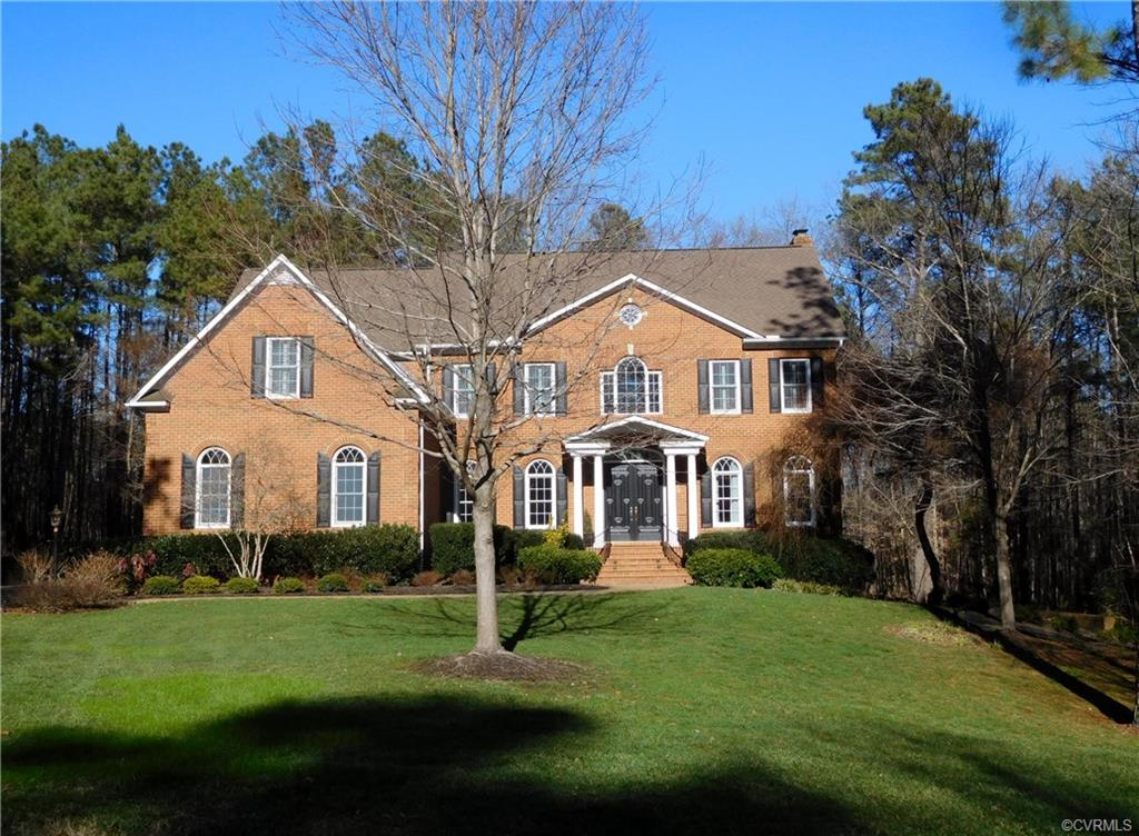 """Come see and come fall in LOVE with this immaculate brick Transitional tucked in a quiet cul-de-sac in Goochland County's most desirable gated community """"RIVERGATE"""". This 6 bedroom, 4.5 bath home features tall ceilings, stunning millwork, beautiful columns and dramatic vaulting. A coffered ceiling family room, gracious formal dining room, a sweeping stairwell in the foyer adds to the character of this handsome home. The granite-top kitchen has a huge center island, a light/bright breakfast room with vaulted ceiling. There are two screened porches for delightful outdoor enjoyment plus a generous deck overlooking the lush wooded 2.5 acre lot.While there are no known defects, all fireplaces, chimneys and flue lines are to be sold """"AS IS""""."""