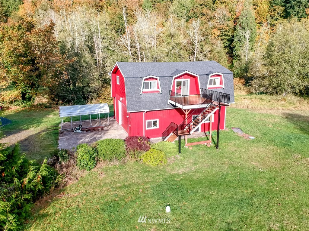 Home w/shop on 3+acres. Charming 3 Bed, 2 Bath home on beautiful Kapowsin Creek. Upper Floor features living, dining, kitchen, 2 beds, full bath. Watch the sunset, salmon & wildlife in the creek from master deck.  1st Floor has full bath & studio/bedroom + garage/shop tall enough for Semi.  Live in entire home or add kitchenette & rent 1st floor for extra income. AC + New Roof, Gutters & Paint. Rm for RV. Upper deck Mt Rainier View. Pasture +woods, 2 Bed Septic, can purchase 4+acre lot in front for extra acreage.